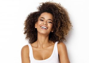 woman smiling curly hair