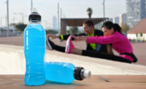 Couple exercising with sports drinks