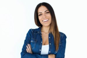 Woman with beautiful smile after cosmetic dental treatments